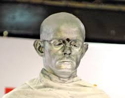 Akshinthala Seshu Babu stood motionless with no facial movements