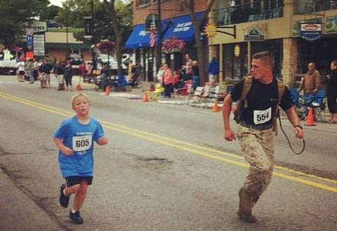 Photo of Marine running with boy posted on Facebook : Goes Viral