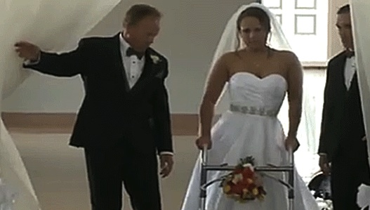 Stevie Beale: Paralyzed bride keeps vow to walk, carried down the aisle by husband