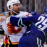 Vancouver Canucks, Calgary Flames : Eight ejected after brawl 2 seconds into game