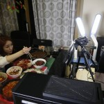 Woman earns $9000 a month eating in front of webcam