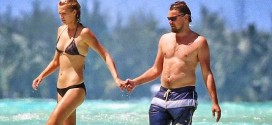DiCaprio Kisses Model Girlfriend as She Goes Topless On Beach Holiday