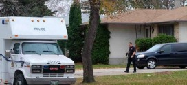 Winnipeg Police search accused woman's home as legal battle continues over autopsies