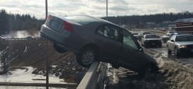 Teen's car teeters : Colin Malone escapes car hanging off bridge over NH river