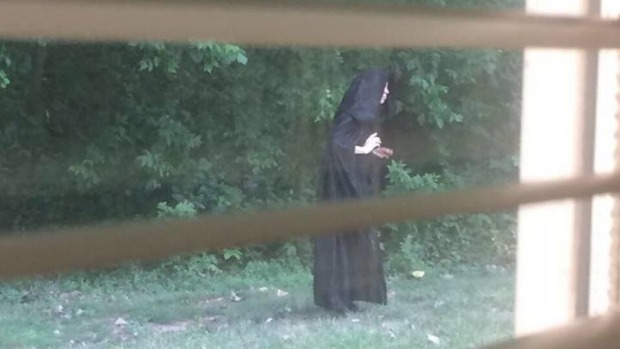 Cloaked figure 39 dropping raw meat on playgrounds 39 in for Flooring gastonia nc