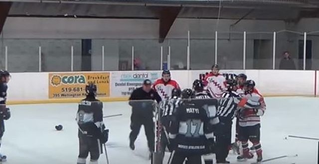 Linesman punches player, gets tackled by trainer (Video)