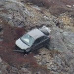 Young Woman Ejected from Tumbling Vehicle on Signal Hill (Video)