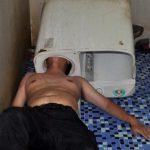 Man gets head stuck in washing machine (Photo)