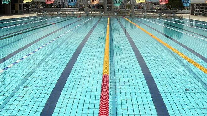 Measuring Swimming Pools : Scientists measure the amount of urine in swimming pools