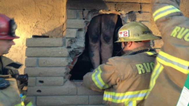 PHOTOS: California Woman Stuck in Chimney, Rescued by