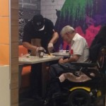 McDonald's Employee Praised For Helping Disabled Man Eat His Meal
