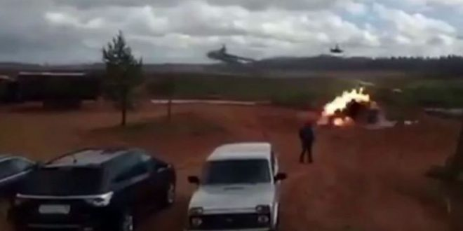 Russian helicopter fires on spectators at drills (Watch)